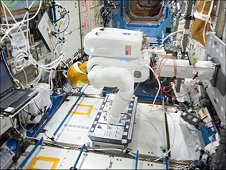 Robonaut-2 performs switch-throws and button presses on a taskboard on the International Space Station. (NASA)