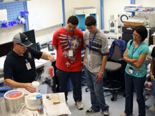 Students view a cryogenics demonstration.