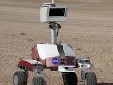 A NASA Ames K10 rover performs a systematic survey of several simulated lunar outpost sites at the robotic field test area in Haughton Crater.