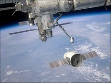 This artist's rendition shows the SpaceX Dragon upon approach to the International Space Station. (NASA)