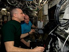 In the International Space Station's Destiny laboratory, NASA astronaut Don Pettit (foreground) and European Space Agency astronaut Andre Kuipers conduct the first of three sessions on the ROBoT simulator in preparation for the arrival of the SpaceX Dragon. Slated for liftoff on May 19, 2012, from the Kennedy Space Center, the goal of Dragon's planned 21-day mission is to test the unpiloted capsule's ability to rendezvous with the space station. (NASA)