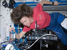 Astronaut Cady Coleman adjusts the fluid volume in the Interior Corner Flow 2 experiment, part of a suite of experiments called the Capillary Flow Experiments-2.  Cady performed this experiment on the space station on January 18, 2011.  (NASA)