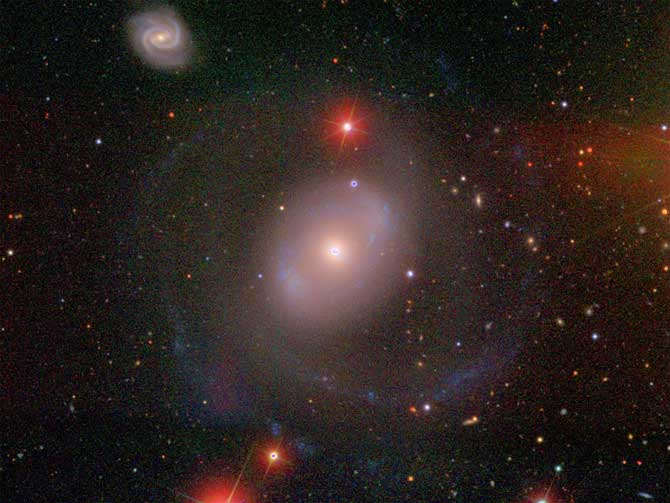 The galaxy NGC 4151 is located about 45 million light years away toward the constellation Canes Venatici.
