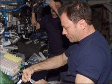 Astronaut Michael Lopez-Alegria, Expedition 14 Commander, prepares a urine sample for the Nutrition investigation. The sample is preserved in the Minus Eighty Degree Freezer, or MELFI, in the Destiny laboratory module. (NASA)