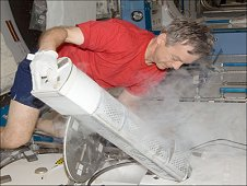 Canadian Space Agency astronaut Robert Thirsk, Expedition 20 flight engineer, performs an insertion of urine samples into the Minus Eighty Degree Laboratory Freezer for ISS, or MELFI, as part of the Nutritional Status Assessment, or Nutrition, study in the Japanese Kibo laboratory of the International Space Station. (NASA)