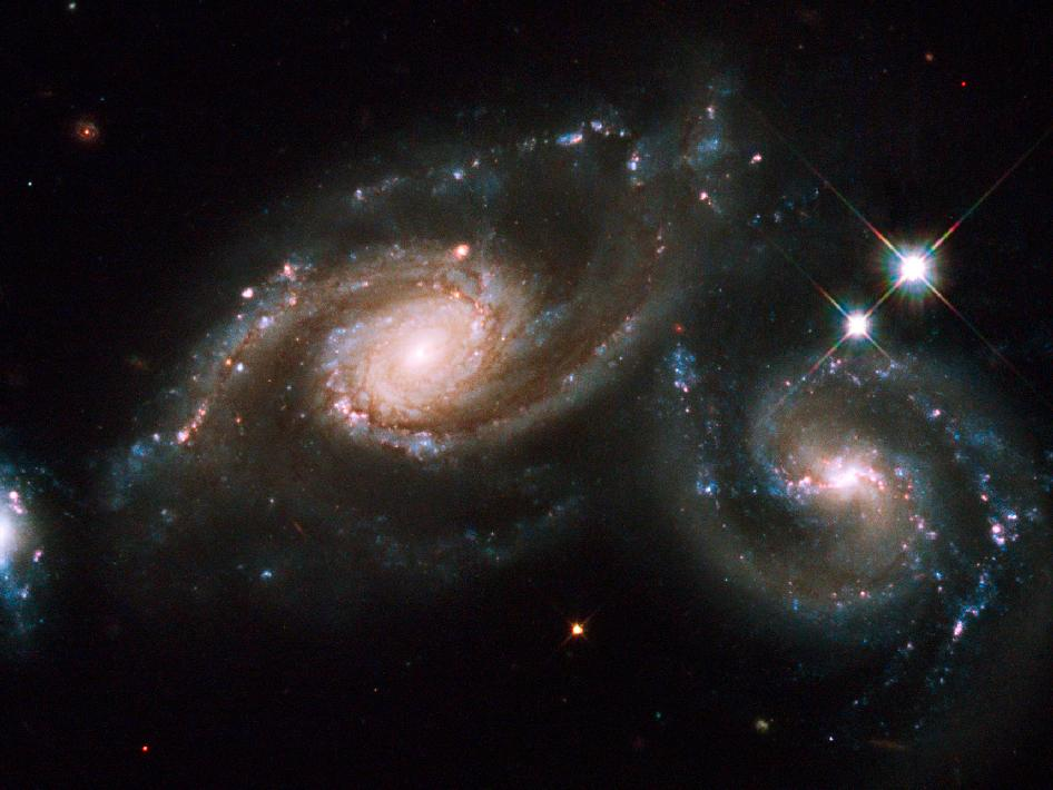 The colliding galaxies of Arp 274 spans about 200,000 light years across and lies about 400 million light years away toward the constellation of Virgo.
