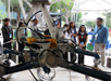 Students watch an engineering model of the Mars Science Laboratory maneuver over simulated Mars rocks