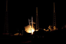 SpaceX Falcon 9 lifts off with Dragon