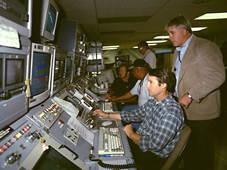 Researchers and technicians monitor a test in the tunnel control room