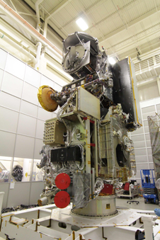 The GMI fully integrated onto the GPM Core Observatory in a clean room at Goddard