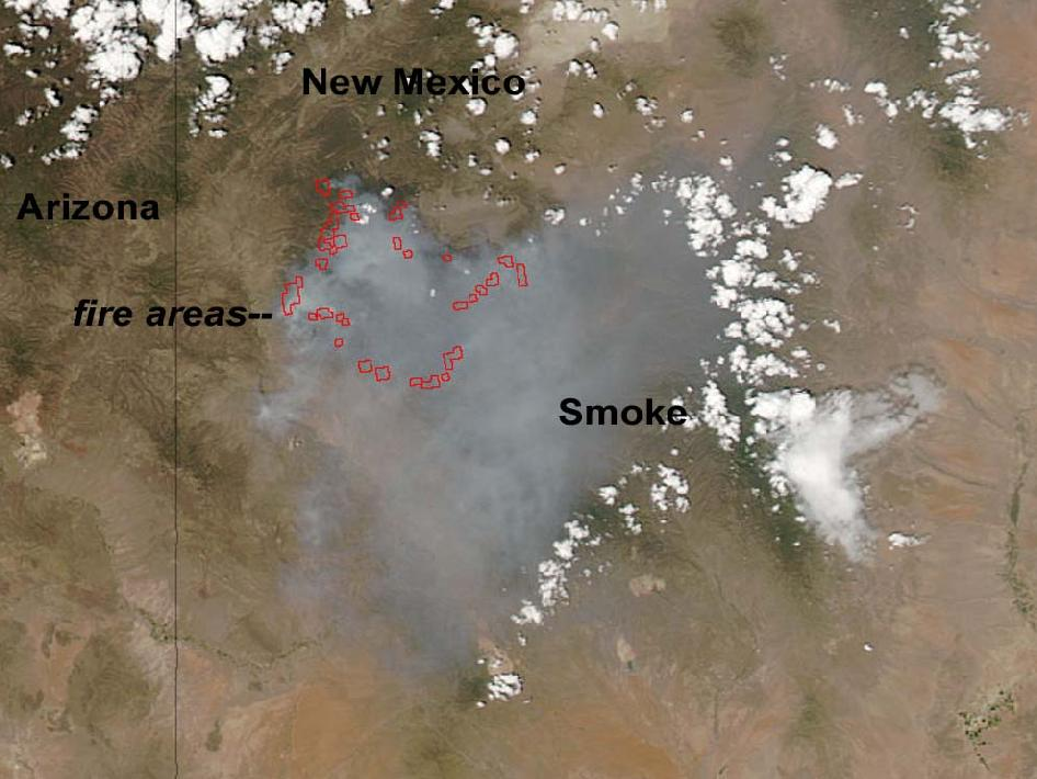 Red spots ring an area of New Mexico under a haze of smoke