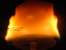 Digital still camera images of a wake flame burning a 2 centimeter-diameter sphere for the BASS investigation. After about a minute, the fuel becomes sufficiently heated to produce a relatively large amount a fuel vapor leading to a long and sooty flame.  (NASA)