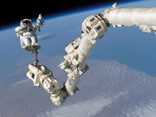 astronaut and Canadarm 2