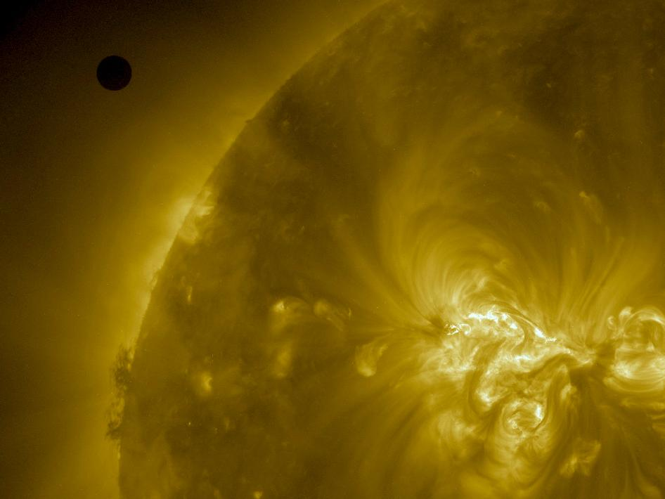 SDO AIA image of Venus and the sun