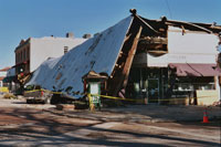 This January 25, 2004 photo shows historic structures and a vehicle damaged in downtown Paso Robles from the 6.5 San Simeon Earthquake.