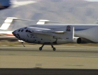 SpaceShipOne lands. Image from Ansari X-Prize Webcast, via NASA TV.