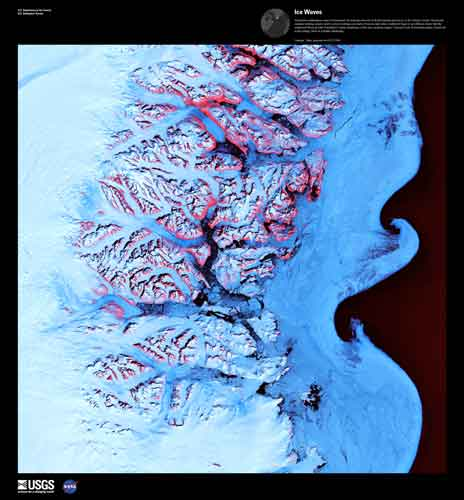 a false-color image of an arctic coastline showing glaciers and the wave-like boundary between ice-choked and clear waters