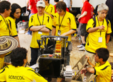 A team of competitors works with its robot during NASA's Lunabotics Mining Competition at the Kennedy Space Center Visitor Complex on May 25.