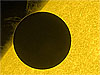 Close-up view of planet Venus near the edge of the sun