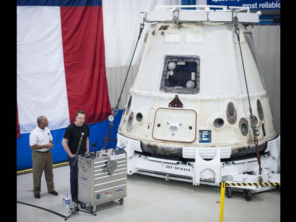 NASA Administrator Charles Bolden, left, and SpaceX CEO and Chief Designer Elon Musk, view the historic Dragon capsule that returned to Earth on May 31 following the first successful mission by a private company to carry supplies to the International Space Station.