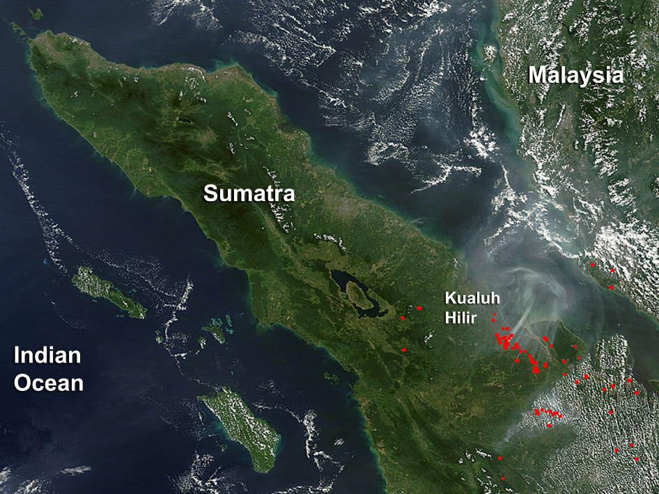 smoke over sumatra blowing across the water toward malaysia