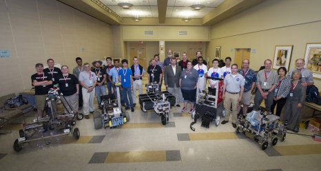NASA and WPI Sample Return Robot Centennial Challenge teams, NASA management, and challenge organizers pose for a group photograph on Saturday, June 16, 2012.