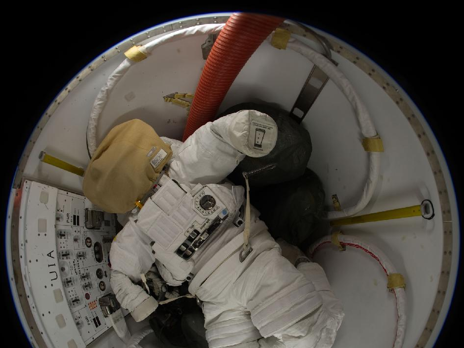 A spacesuit in the Quest airlock