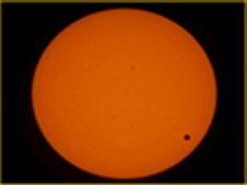 These images were taken by the Expedition 31 crew aboard the International Space Station during the Transit of Venus event. The small dot represents Venus passing across the sun. (NASA)