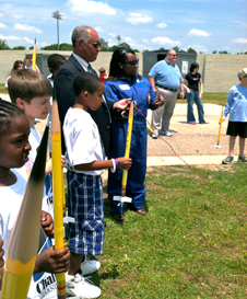 NASA Administrator Charlie Bolden standing with students participating in a Summer of Innovation rocket activity