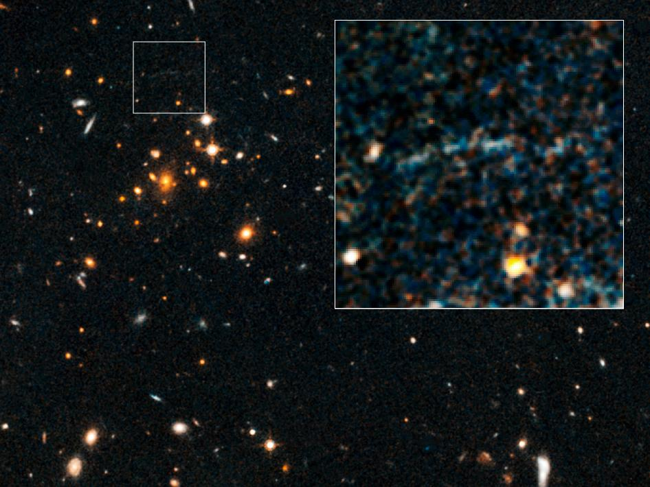 NASA's Hubble Spots Rare Gravitational Arc from Distant, Hefty Galaxy Cluster