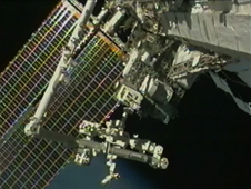 RRM (center, on platform) uses Canadarm2 and the Canadian Dextre robot (left and bottom, foreground) to demonstrate satellite-servicing tasks.