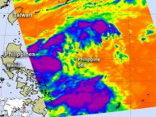 Infrared data from AIRS iindicated the there were still some strong (purple) showers and thunderstorms within Doksuri.