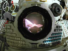 View looking through Mir Space Station Base Block periscope with the Spektr module and Earth limb in view.