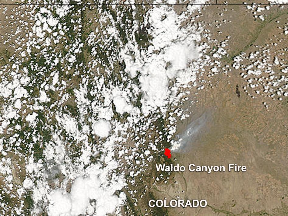 This image was captured on June 26, 2012 and shows fires color coded as red areas in imagery and smoke appears in light brown.