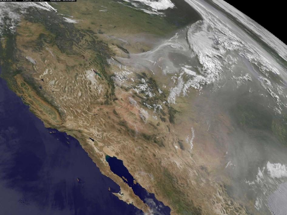 The GOES-15 sees the smoke from the fires raging in the western U.S. have created a brownish-colored blanket over the region.