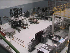 grainy webb-cam image of the Goddard High-Bay cleanroom showing the James Webb instrument support structure and MIRI in the background.