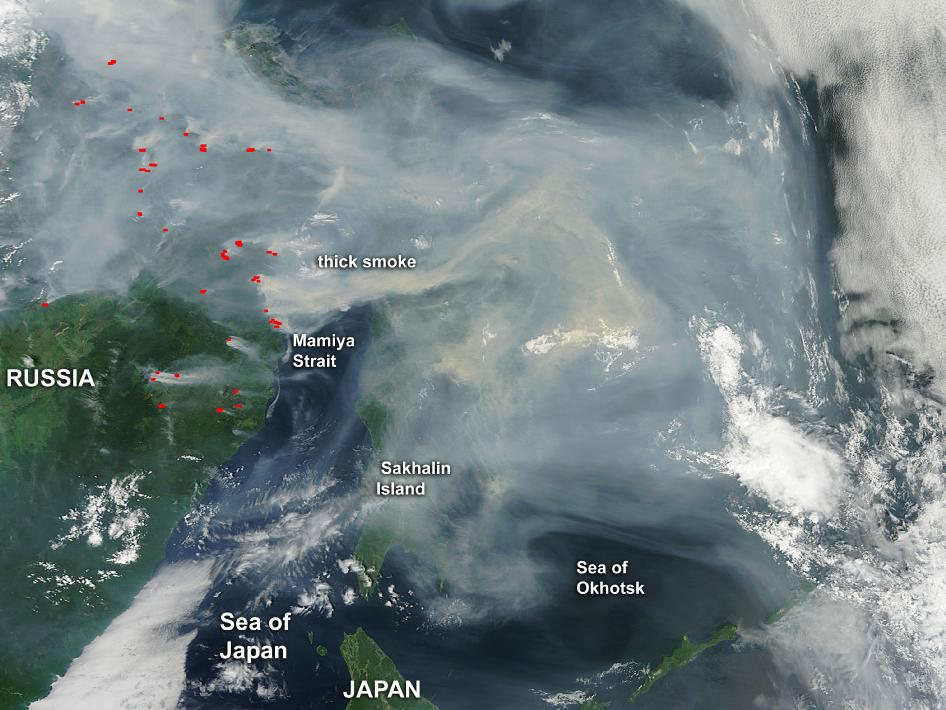 This image shows a thick blanket of smoke blowing over the Sea of Okhotsk. The smoke is a result of many forest fires burning in eastern Russia.