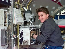 Astronaut Cady Coleman works with the Protein Crystal Growth Glovebox study in the U.S. Microgravity Laboratory 2 Spacelab science module. (NASA)