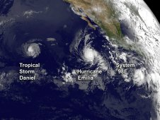 NOAA's GOES-15 satellite captured three tropical cyclones spinning in the eastern Pacific Ocean today, July 10, 2012.