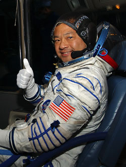 Expedition 10 Commander Leroy Chiao gives a 'thumbs up' on the way to launch