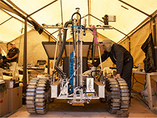 The Canadian Space Agency (CSA)'s Artemis Jr. rover and the Regolith and Environment Science and Oxygen and Lunar Volatiles Extraction (RESOLVE) system being prepared for the simulated mission. Photo credit: NASA/Joe Bibby