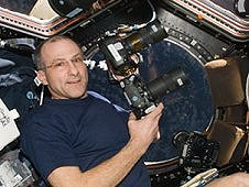 Expedition 30 Flight Engineer, Don Pettit uses still cameras to photograph the Earth from the window of the International Space Station's Cupola module. (NASA)