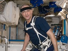 NASA astronaut Don Pettit, Expedition 30 flight engineer, equipped with a bungee harness, prepares to exercise on the Combined Operational Load Bearing External Resistance Treadmill, or COLBERT, in the Tranquility node of the International Space Station. (NASA)