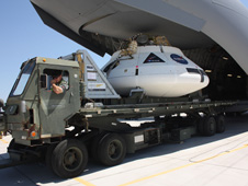 jsc2012e103026 -- The Orion team loads a test version of the spacecraft into a C-17 in preparation for a parachute drop test