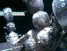 Expedition 10 arrives at the International Space Station.