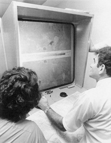 scientists in view a Landsat enlargement on a special machine in 1972