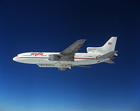 The 'Stargazer' L-1011 flies high with a Pegasus rocket fastened to its underbelly.
