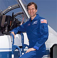 Thomas H. (Tom) Marshburn poses with a T-38 jet trainer aircraft at Ellington Field