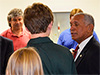 Charles Bolden, NASA administrator, talks with students about experiments flying on the COTS Demonstration mission.