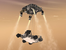 This artist's concept shows the sky crane maneuver during the descent of the Curiosity rover to the Martian surface.